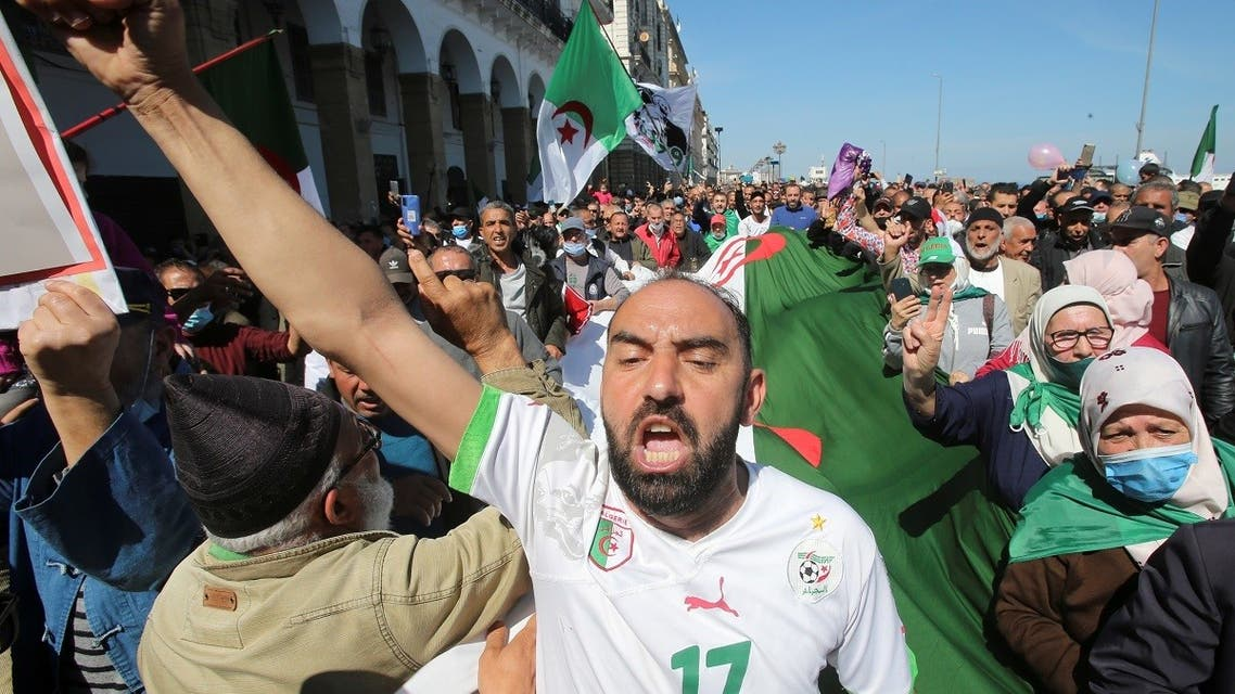 A demonstrator gestures during a protest demanding political change, in Algiers. (Reuters)
