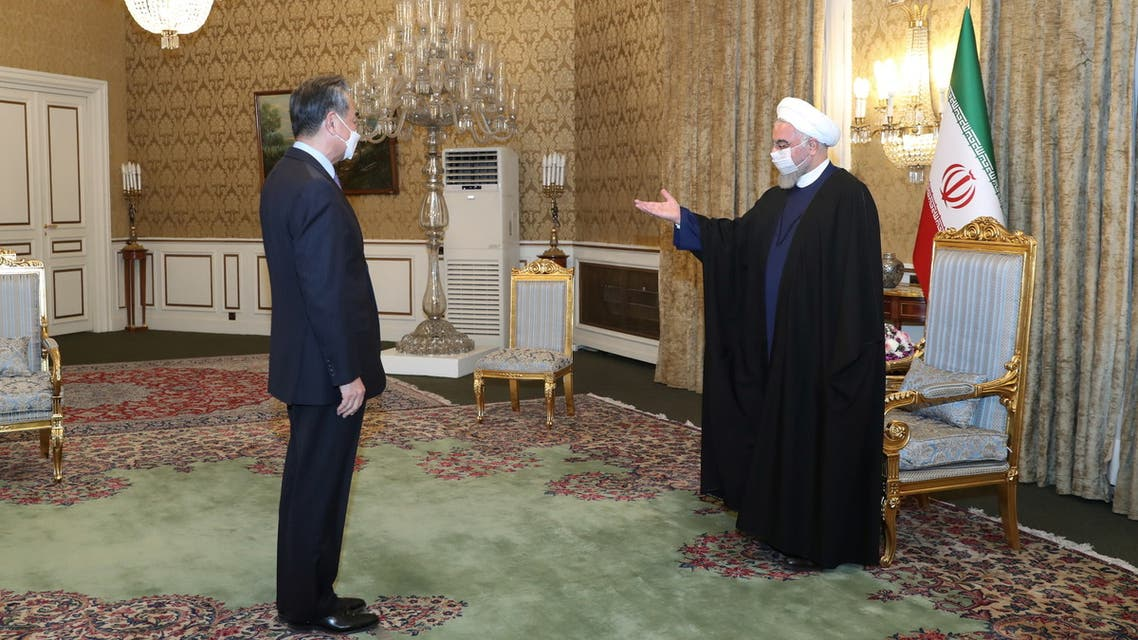 Iranian President Hassan Rouhani meets with Chinese Foreign Minister Wang Yi, in Tehran. (Reuters)
