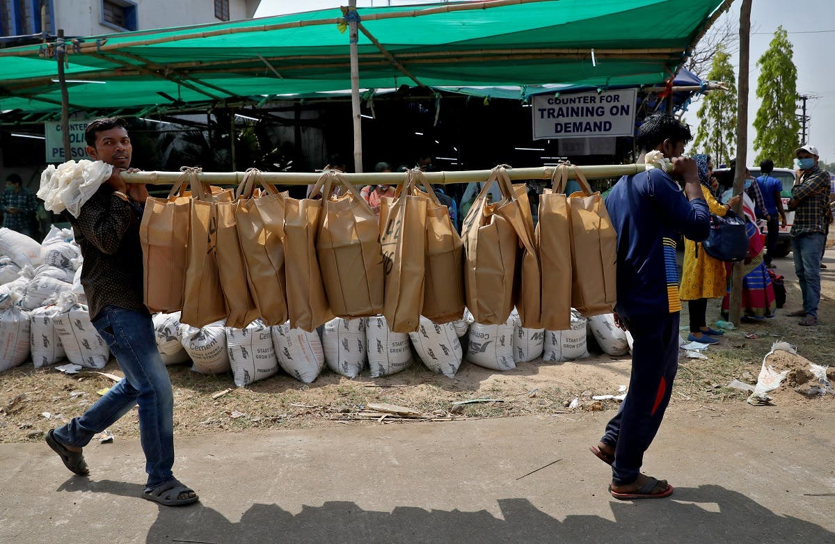 Election workers carry bags of election material at a distribution centre ahead of the first phase of West Bengal state assembly election, in Purulia district, India. (Reuters)