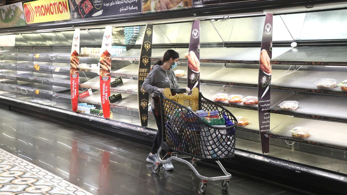 A customer pushes her trolley next to near empty shelves after people hoarded food as authorities are discussing the latest measures to implement to curb the spread of the coronavirus disease (COVID-19), in Beirut, Lebanon, January 11, 2021. (File photo: Reuters)