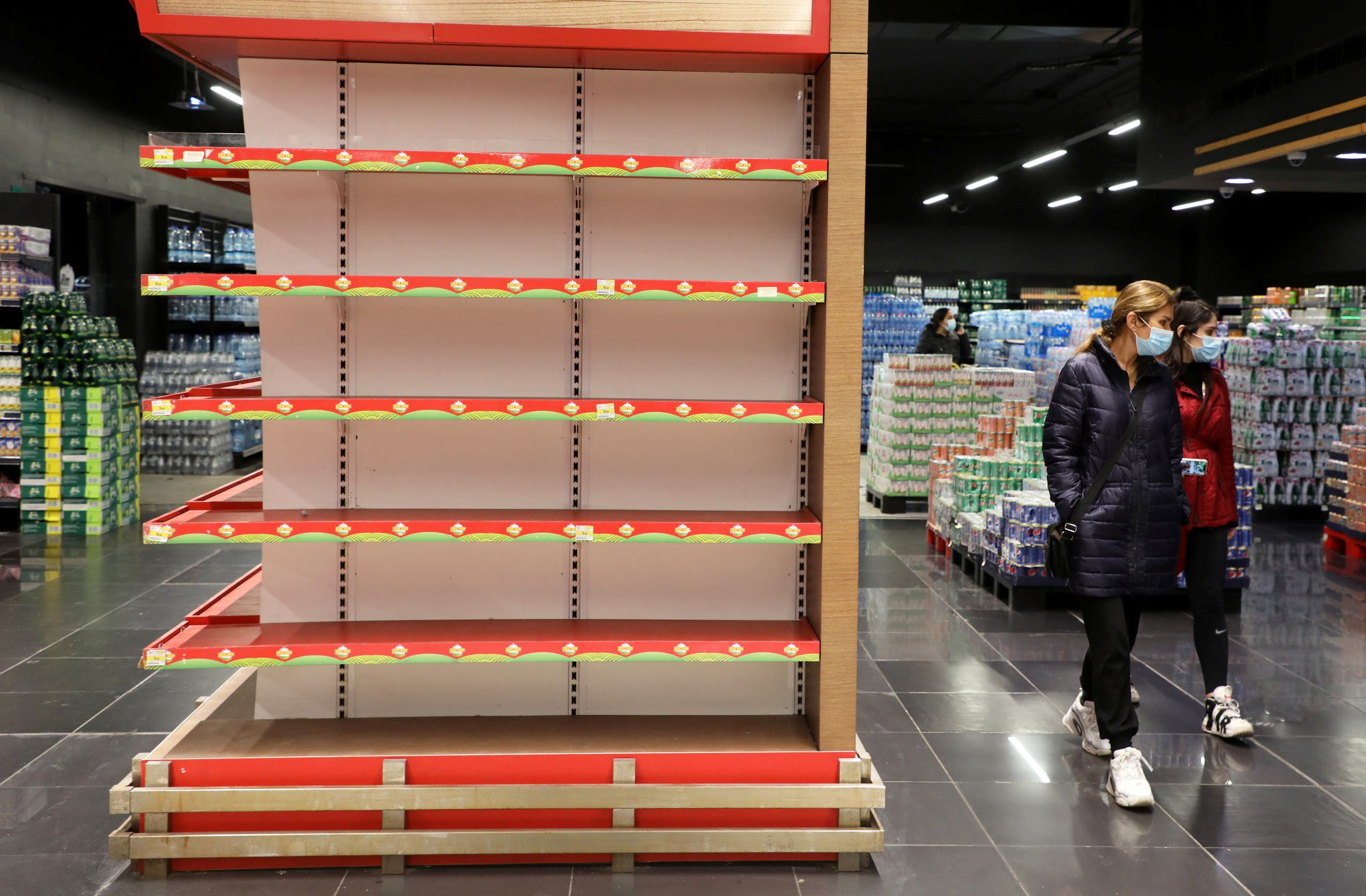 Shoppers walk past an empty shelf at a supermarket in Beirut, Lebanon March 16, 2021. Picture taken March 16, 2021. (File photo: Reuters)