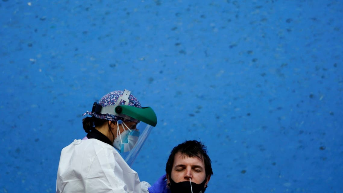 A nurse conducts a PCR (polymerase chain reaction) swab test on a resident of the Basque town of Elorrio during mass testing, following an upsurge of coronavirus disease (COVID-19) cases in the municipality, in Elorrio, Spain March 23, 2021. (File photo: Reuters)