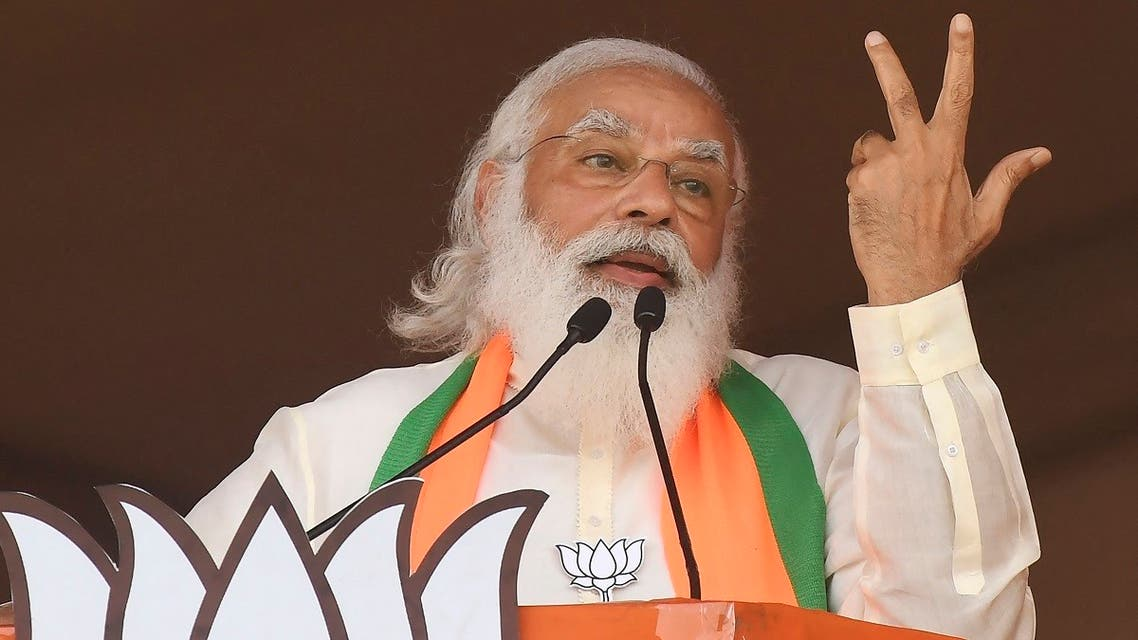 India's Prime Minister Narendra Modi addresses supporters of the Bharatiya Janata Party (BJP) during a mass rally ahead of the state legislative assembly elections at the Brigade Parade ground in Kolkata on March 7, 2021. (AFP)