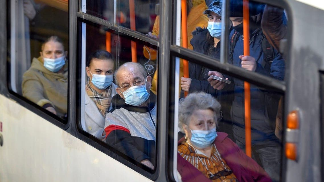 People wear masks on a crowded tram during a subway workers strike which forced commuters to use the surface public transportation in Bucharest, Romania, March 26, 2021. (AP/Andreea Alexandru) (1)
