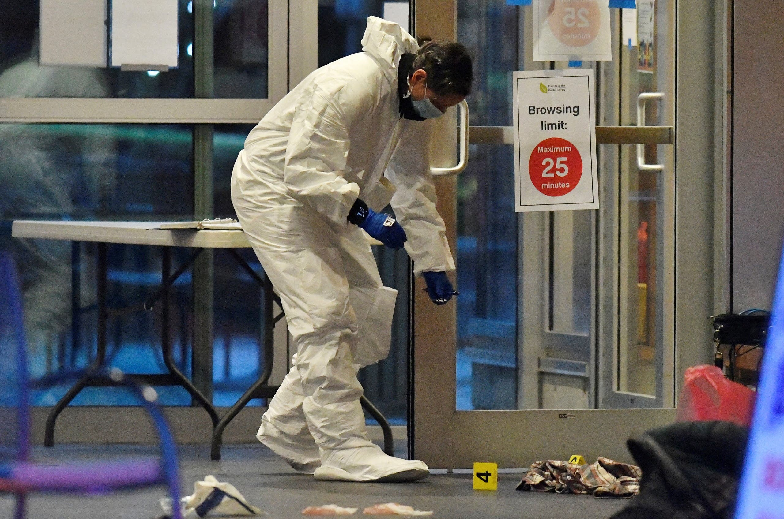 A first responder works at a crime scene where police say multiple people were stabbed by a suspect at a Vancouver Library in Canada. (Reuters)