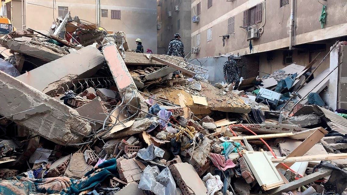 Emergency workers sift through the rubble of a collapsed apartment building in the el-Salam neighborhood, Saturday, March 27, 2021, in Cairo, Egypt. (AP)