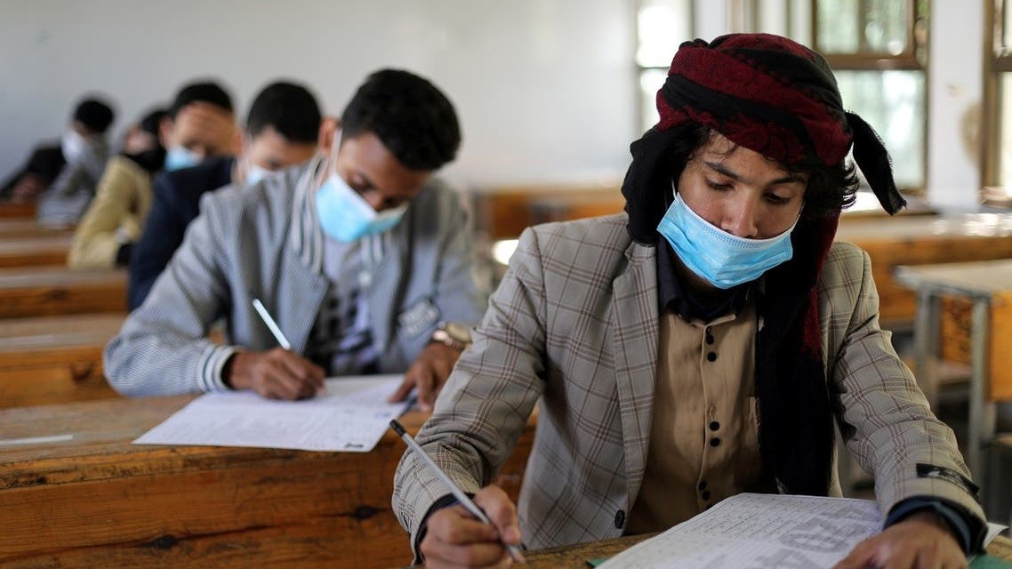 High school students wear protective face masks as they attend final exams amid concerns of the spread of the coronavirus disease (COVID-19) in Sanaa, Yemen. (Reuters)