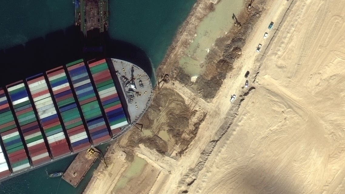 A view of the earth moving equipment excavating sand near the bow of the Ever Given container ship, in Suez Canal in this Maxar Technologies satellite image taken on March 27, 2021. Satellite image. (Maxar Technologies/Handout via Reuters)