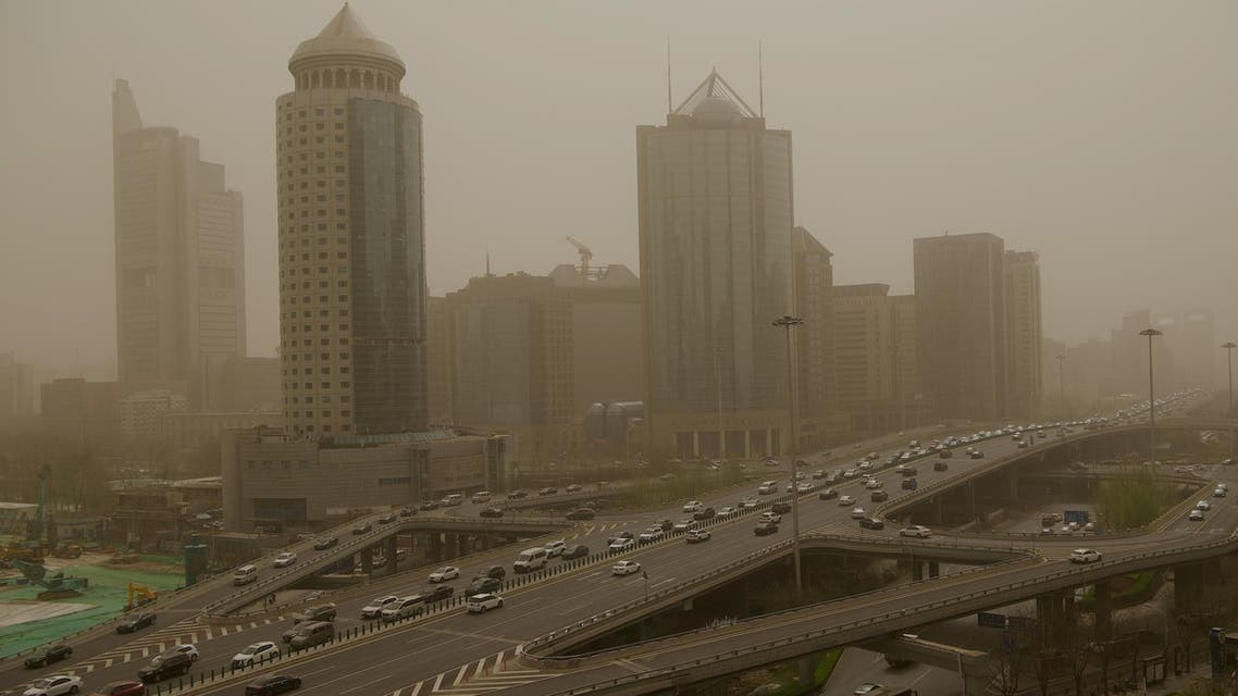 Motorists commute during a sandstorm in Beijing on March 28, 2021. (AFP)