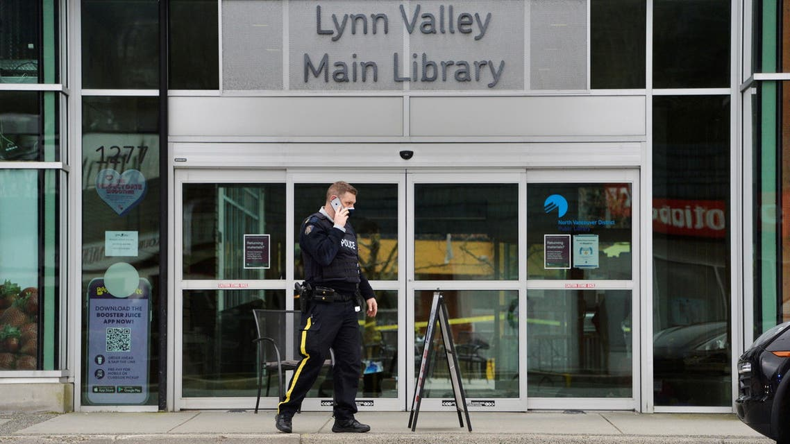 A police personnel speaks on the phone at a Vancouver library, where police said multiple people were stabbed in Canada March 27, 2021. (Reuters)