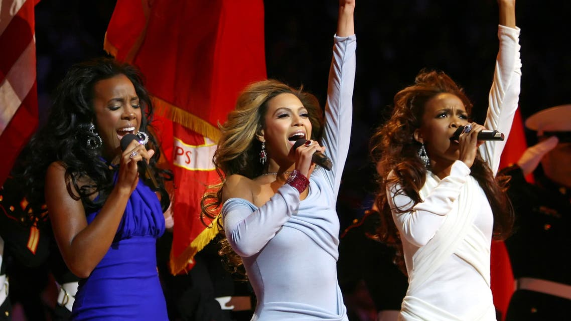 Destiny's Child singers Kelly Rowland (L), Beyonce Knowles (C), and Michelle Williams sing the national anthem at the 55th NBA All-Star Game in Houston, Texas February 19, 2006. (File photo: Reuters)