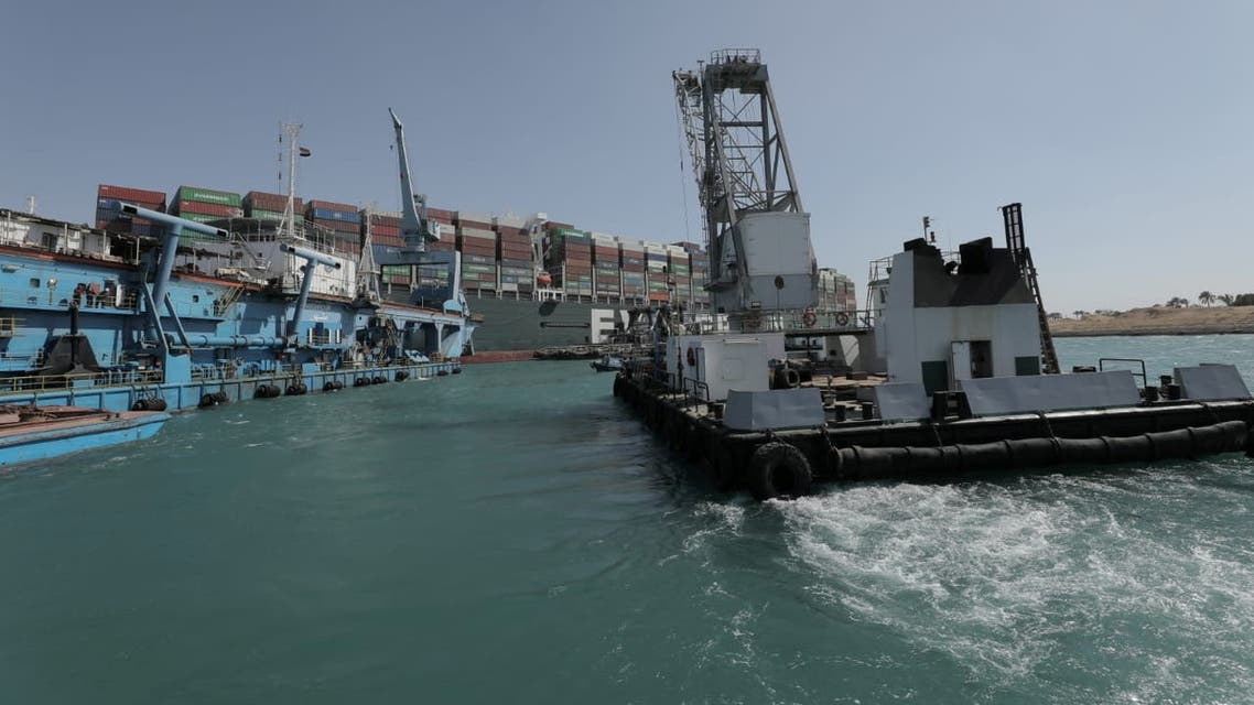 Dredgers attempt to free stranded ship Ever Given, one of the world's largest container ships, in Suez Canal. (Reuters)