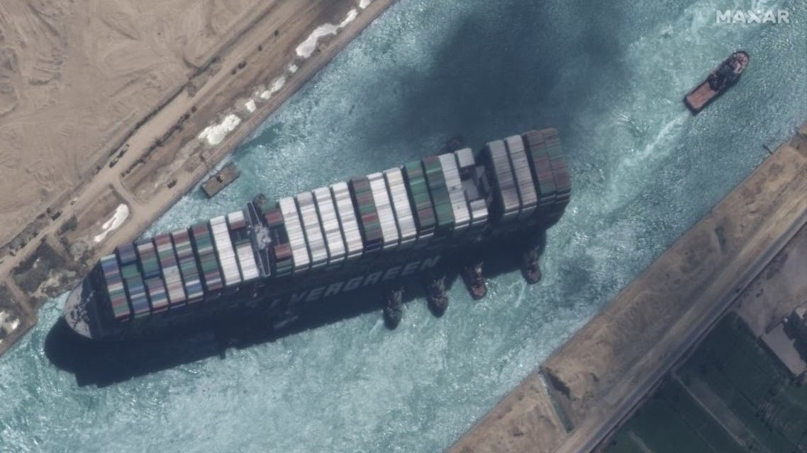 This satellite imagery released by Maxar Technologies shows a close up overview of the MV Ever Given container ship and tugboats in the Suez Canal on March 29, 2021. (AFP)