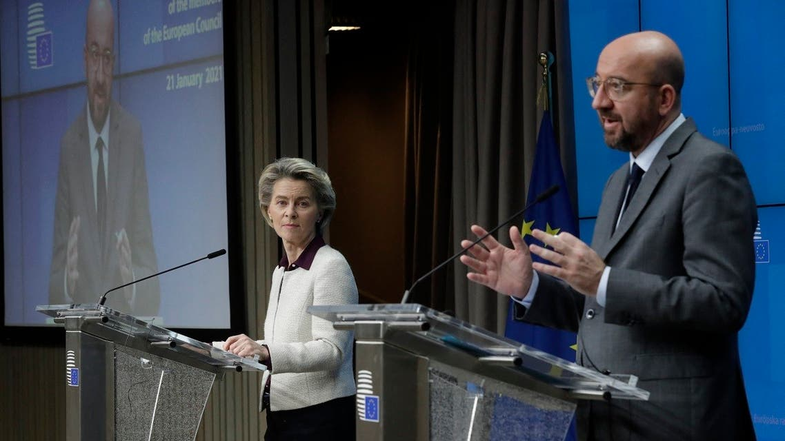 European Commission President Ursula von der Leyen (L) and European Council President Charles Michel give a presser at the end of a video conference meeting of the members of the European Council focused on the Covid-19 (novel coronavirus) pandemic, in Brussels, on January 21, 2021. (Olivier Hoslet/Pool/AFP)
