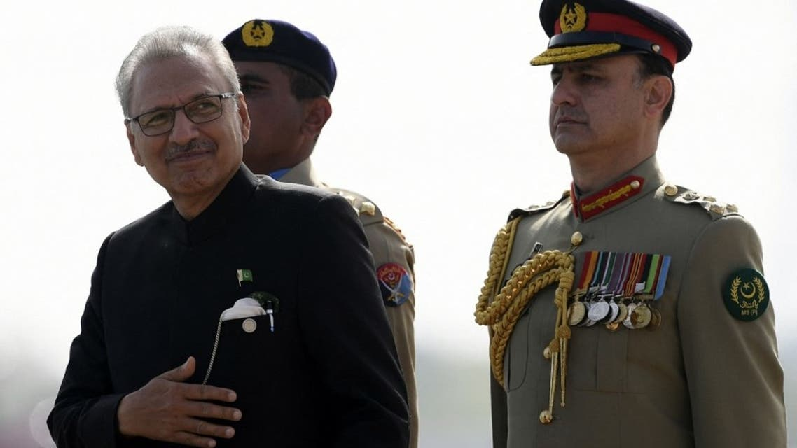 Pakistan's President Arif Alvi (L) inspects the guard of honour during the military parade to mark Pakistan's National Day in Islamabad on March 25, 2021. (AFP)