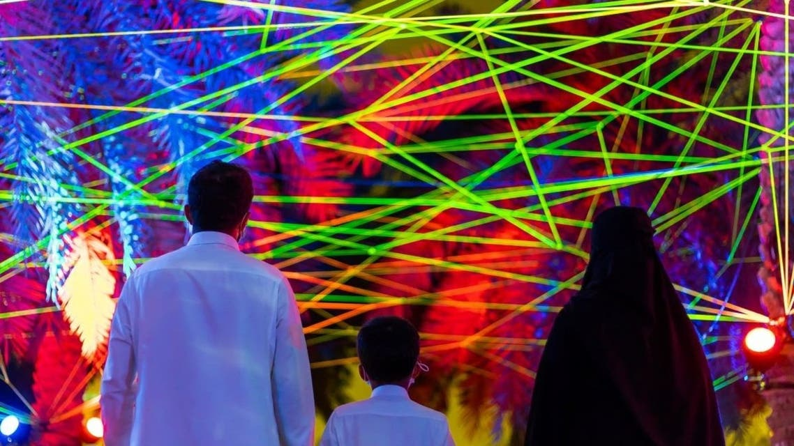 Saudi citizens enjoying Tom & Lien Dekyvere's 'Rhizome'  (2021) at the Palm Oasis in Riyadh. (Courtesy: Riyadh Art 2021)