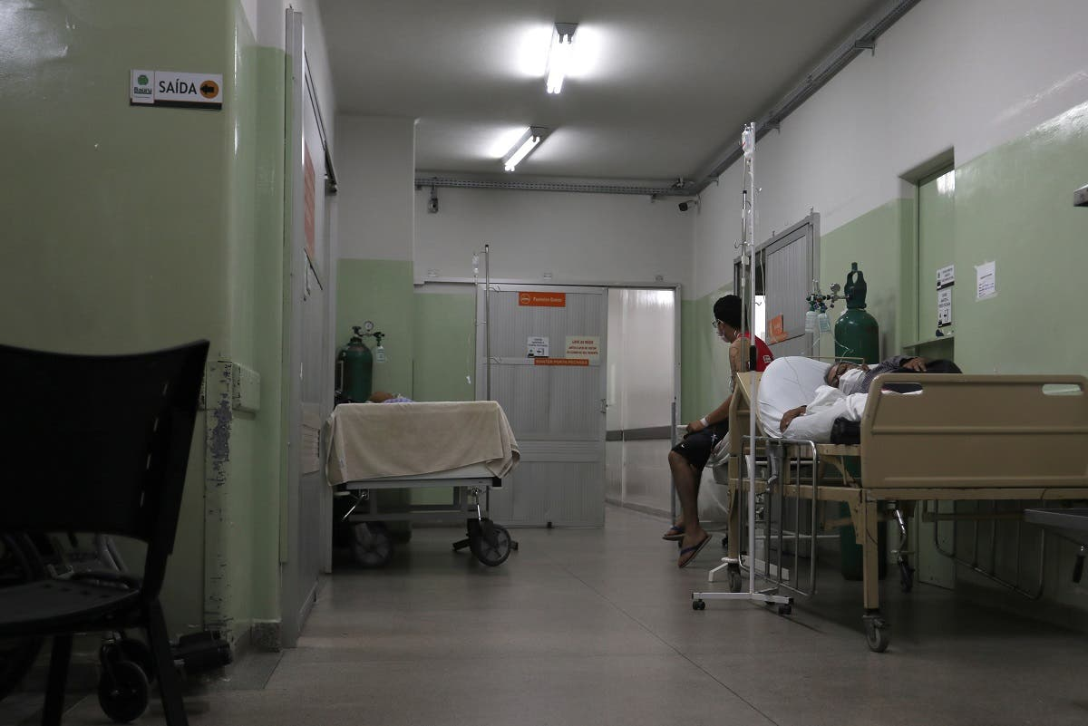 A patient, who tested positive for the coronavirus waits in the corridor to be transferred to the ICU in the Central Emergency Room in Bauru, Sao Paulo state, Brazil March 23, 2021. Picture taken March 23, 2021. (Reuters/Leonardo Benassatto)