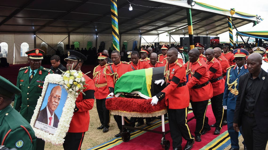 Personnel of the Tanzania People's Defence Force (TPDF) move the coffin of the late Tanzanian President John Magufuli for the burial after the farewell mass at Magufuli Stadium in Chato, Tanzania, on March 26, 2021. (AFP)