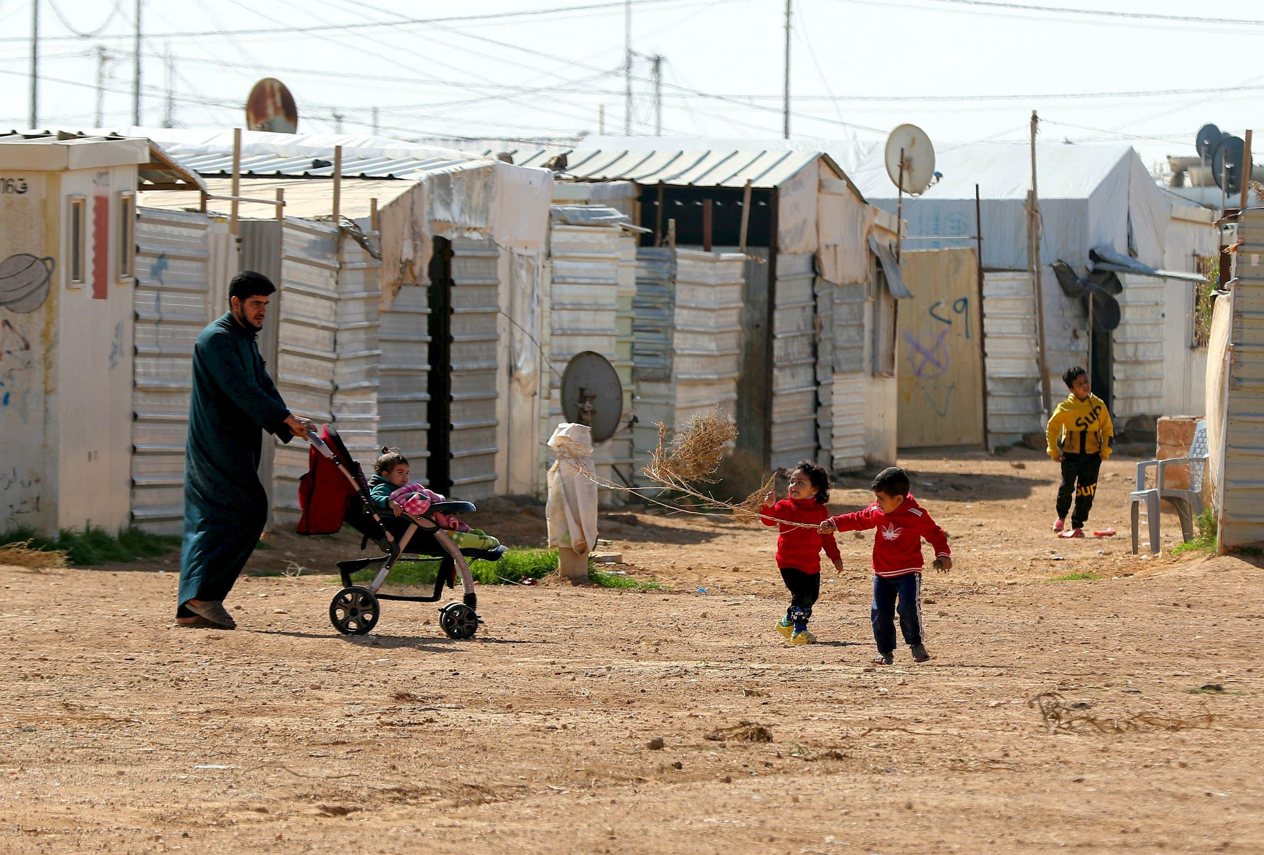 Syrian children play in the Zaatari refugee camp, 80 kilometers (50 miles) north of the Jordanian capital Amman on February 15, 2021.