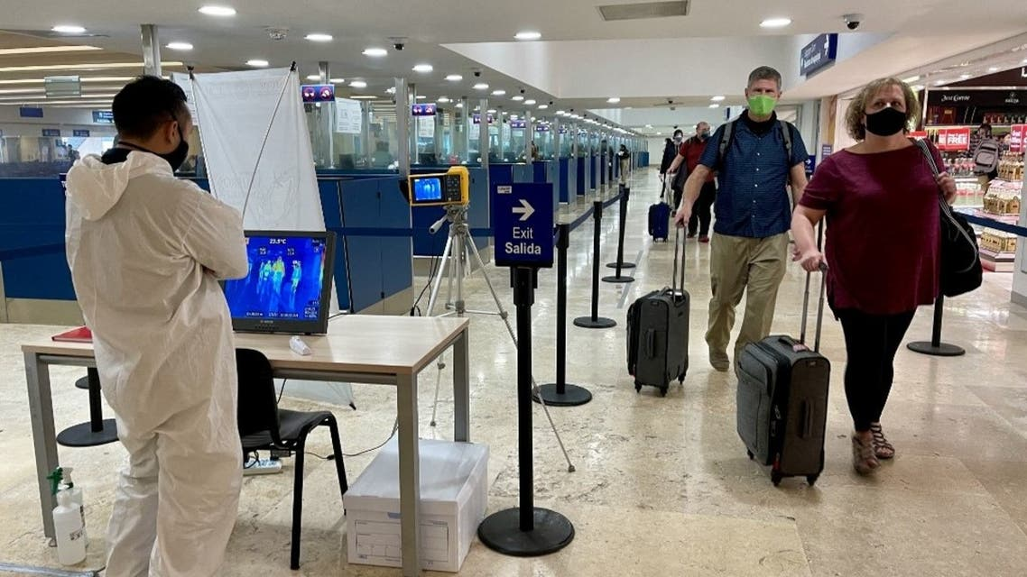 In this file photo taken on March 02, 2021 an operator watches a no-contact thermal camera for fever control amid the COVID-19 novel coronavirus pandemic, at Cancun International Airport in Cancun, Quintana Roo State, Mexico. (AFP)