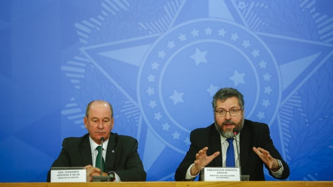 In this file photo taken on February 4, 2020 Foreign Minister Ernesto Araujo (R) speaks next to Defense Minister Fernando Azevedo e Silva during a press conference regarding the evacuation of Brazilian citizens from Wuhan. (AFP)