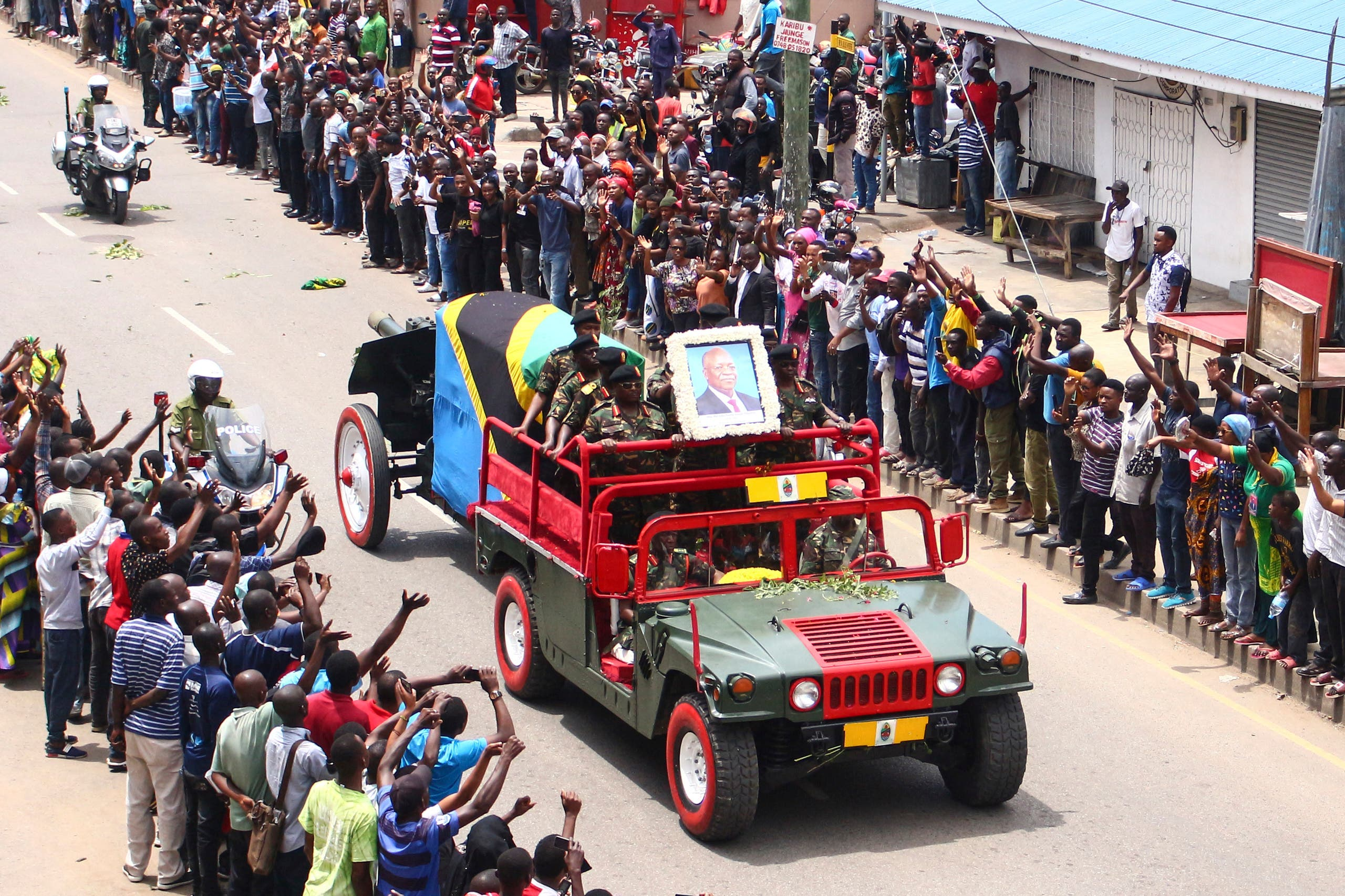 The coffin of the late Tanzanian President John Magufuli passes on a road for his funeral in Mwanza, Tanzania, on March 24, 2021. (AFP)