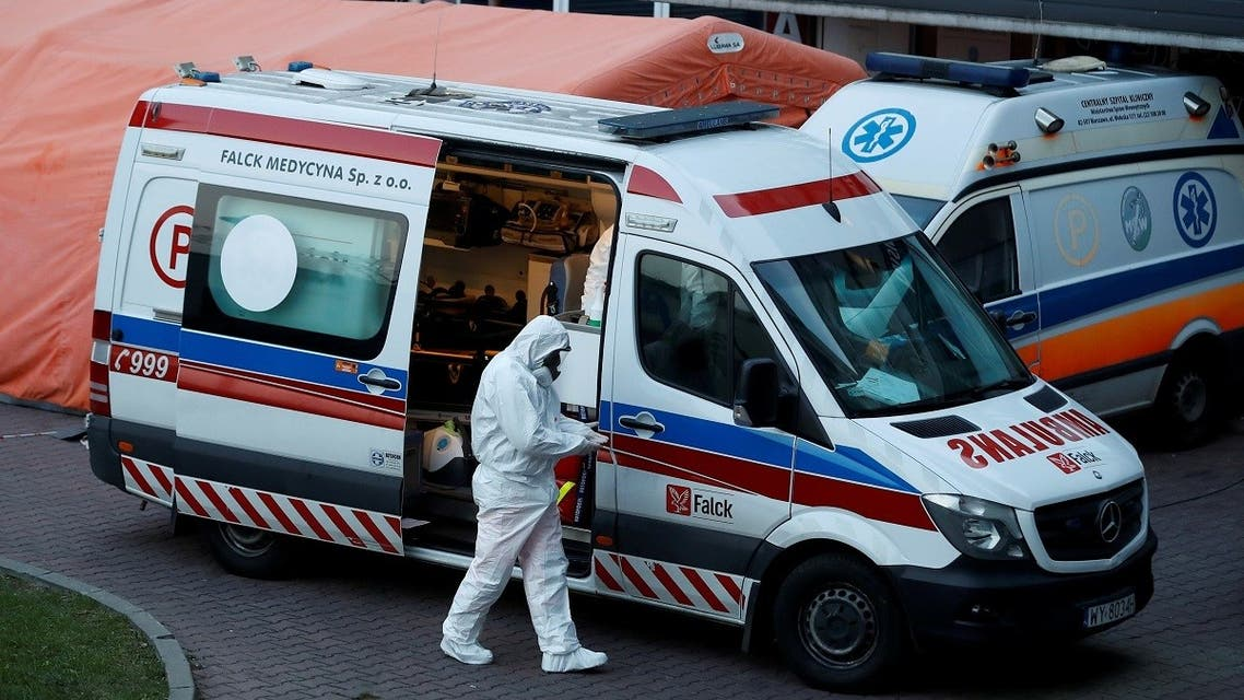 A paramedic walks near an ambulance amid the coronavirus outbreak, in front of a hospital in Warsaw, Poland December 3, 2020. (Reuters/Kacper Pempel)