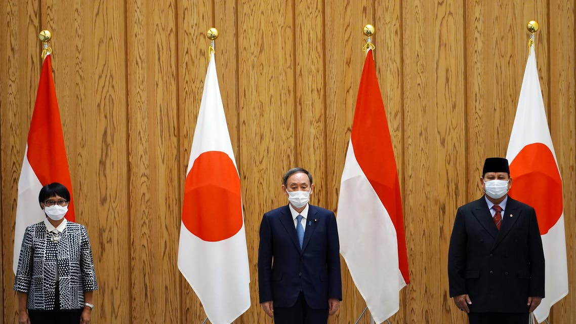 Japan's Prime Minister Yoshihide Suga poses with Indonesia's Foreign Minister Retno Marsudi and Defense Minister Prabowo Subianto during a courtesy call at the prime minister's official residence in Tokyo, Japan, March 30, 2021. (Reuters)