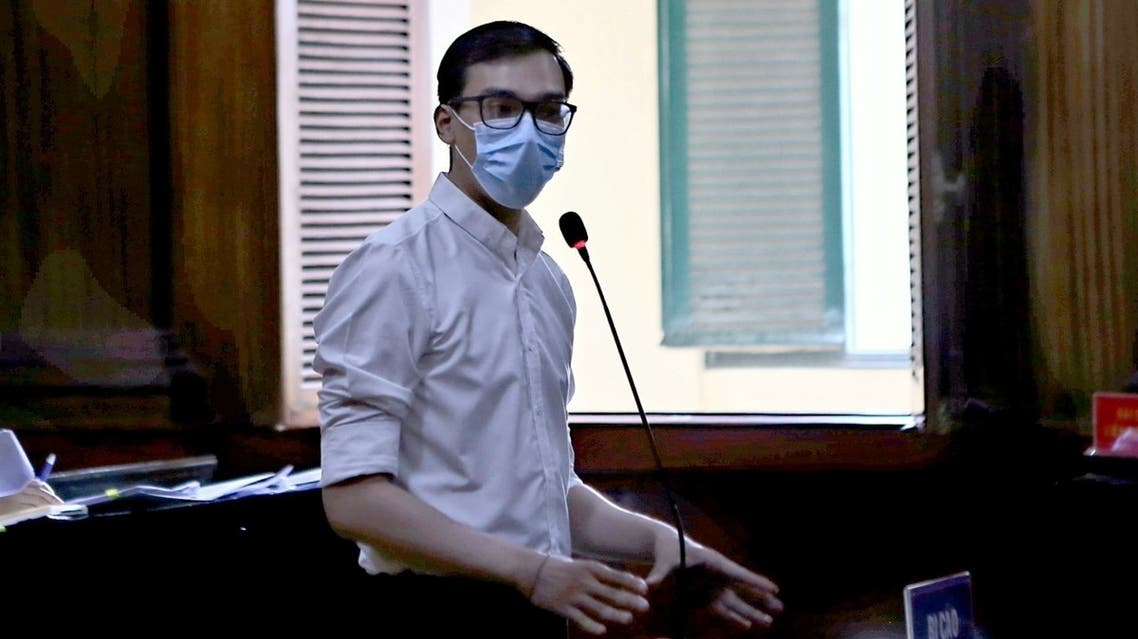 Vietnam Airlines flight attendant Duong Tan Hau, addresses the court before being found guilty of violating COVID-19 quarantine rules and handed a two year suspended prison term in Ho Chi Minh City, Vietnam March 30, 2021. VNA via REUTERS THIS IMAGE HAS BEEN SUPPLIED BY A THIRD PARTY. NO RESALES. NO ARCHIVES