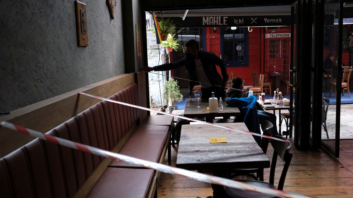 Tables and seats are taped off to provide social distancing inside a cafe that reopened after the coronavirus disease (COVID-19) restrictions were eased, in Istanbul, Turkey March 2, 2021. (File photo: Reuters)