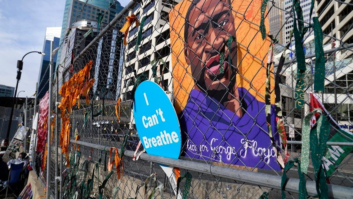 A picture of George Floyd hangs on a fence outside the Hennepin County Government Center, March 30, 2021, where the trial for former Minneapolis police officer Derek Chauvin continues. (AP)