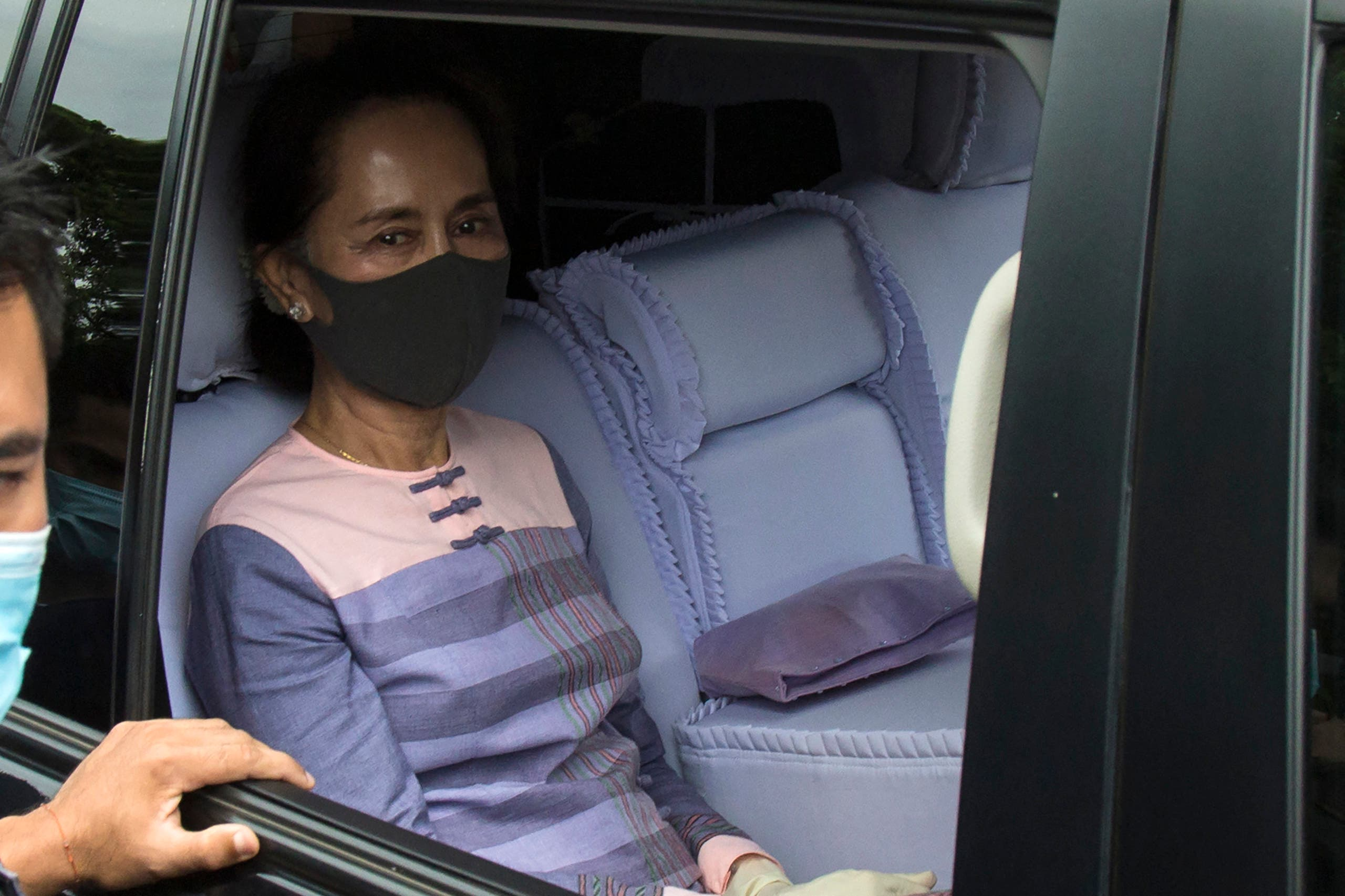 Myanmar State Counsellor Aung San Suu Kyi looks out from a vehicle as she leaves the Yangon southern district court after she submitted her application to run as a candidate in the upcoming 2020 general election in Yangon on August 4, 2020. Myanmar will hold its next general election on November 8, in a test for the country's fledgling democratic government led by Aung San Suu Kyi.
