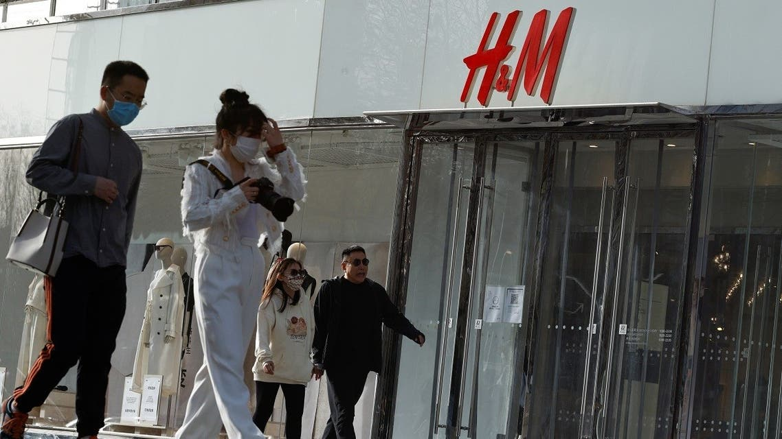 People walk past an H&M store in a shopping area in Beijing, China, on March 28, 2021. (Reuters)