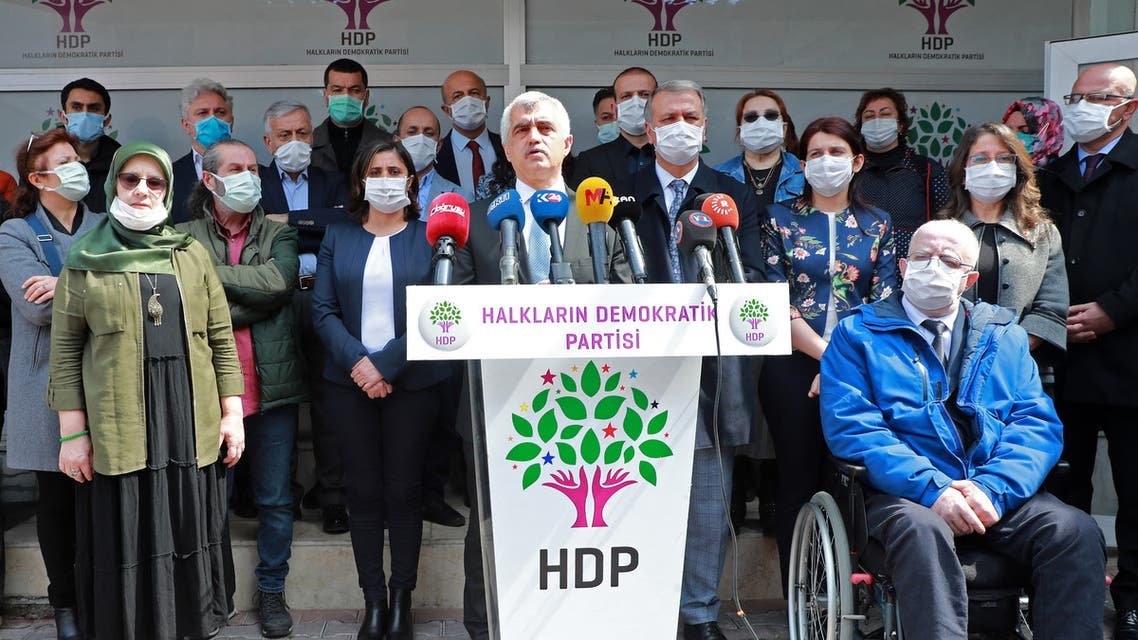 Pro-Kurdish Peoples' Democratic Party's (HDP) Turkish MP Omer Faruk Gergerlioglu, who was expelled from the parliament earlier this month, holds a press conference on March 31, 2021 at the party's headquarters in the Turkish capital, Ankara.