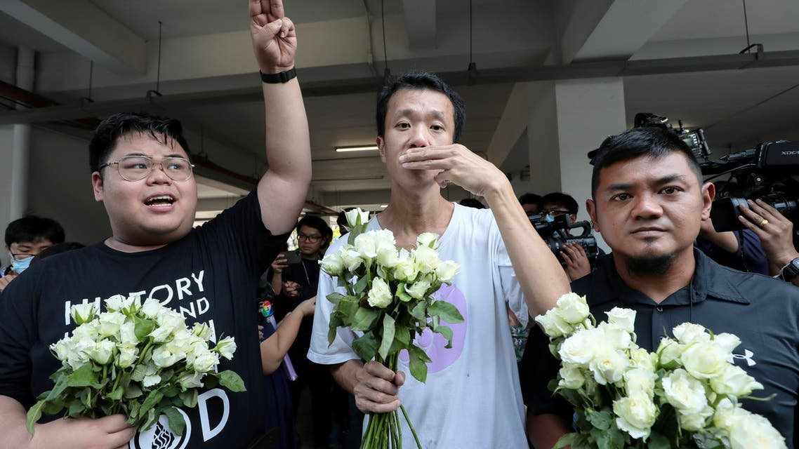 (L-R) Bunkueanun Francis Paothong, 21, Ekachai Hongkangwan, 45, and Suranat Panprasert, 35, flash three fingers salutes as they turn up at the attorney general's office after being on charges of attempted violence against the queen during a pro-democracy demonstration last year, when a royal motorcade encountered dozens of protesters, in Bangkok, Thailand March 31, 2021. (Reuters)