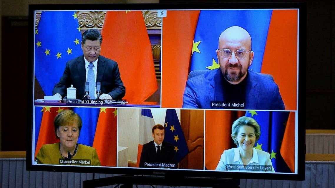European Commission President Ursula von der Leyen, European Council President Charles Michel, German Chancellor Angela Merkel, French President Emmanuel Macron and Chinese President Xi Jinping are seen on a screen during a video conference, in Brussels, Belgium, on December 30, 2020. (Reuters)