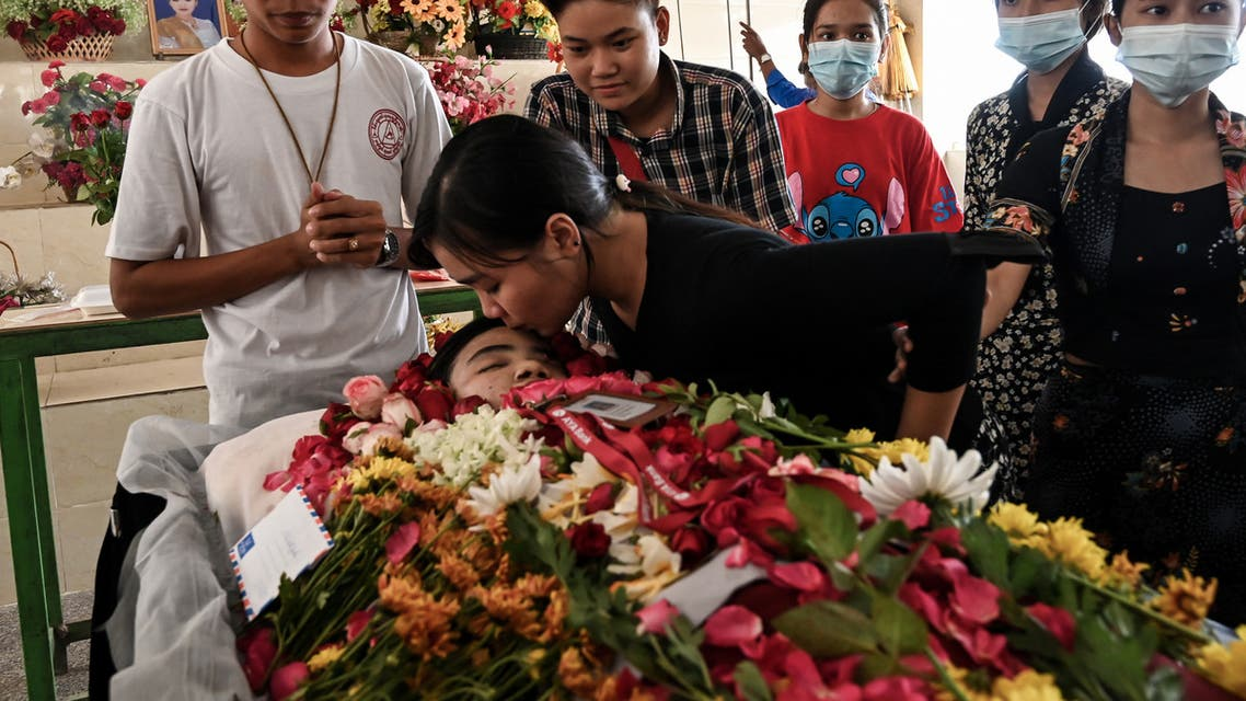 A relative of Khine Zar Twal, who died on March 28 during a protest amid a crackdown by security forces on demonstrations against the military coup, kisses her forehead during her funeral in Yangon on March 30, 2021. (File photo: AFP)