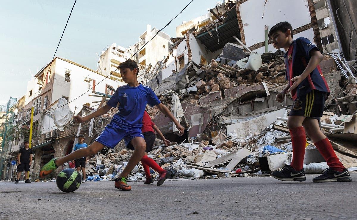 أطفال يلعبون في الجميزة (فرانس برس)