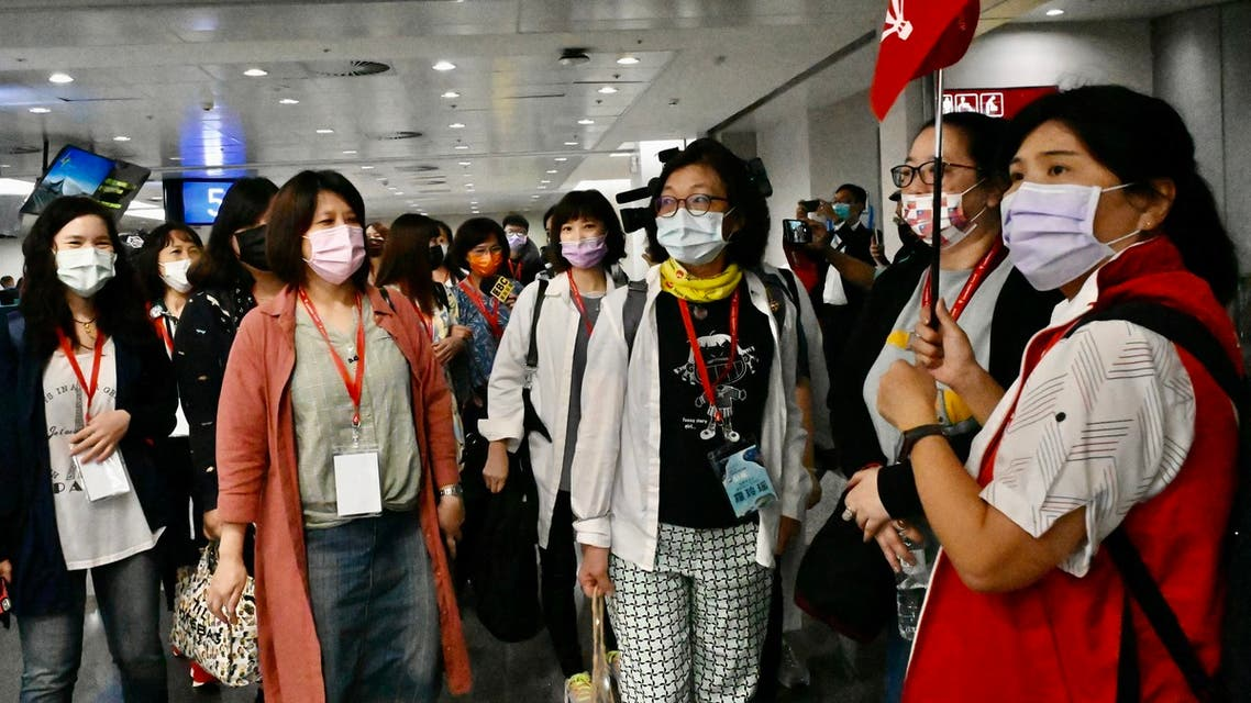 Taiwan tourists arrive at Taoyuan International Airport near Taipei on April 1, 2021, before heading to Palau as part of a travel bubble plan. (File photo: AFP)