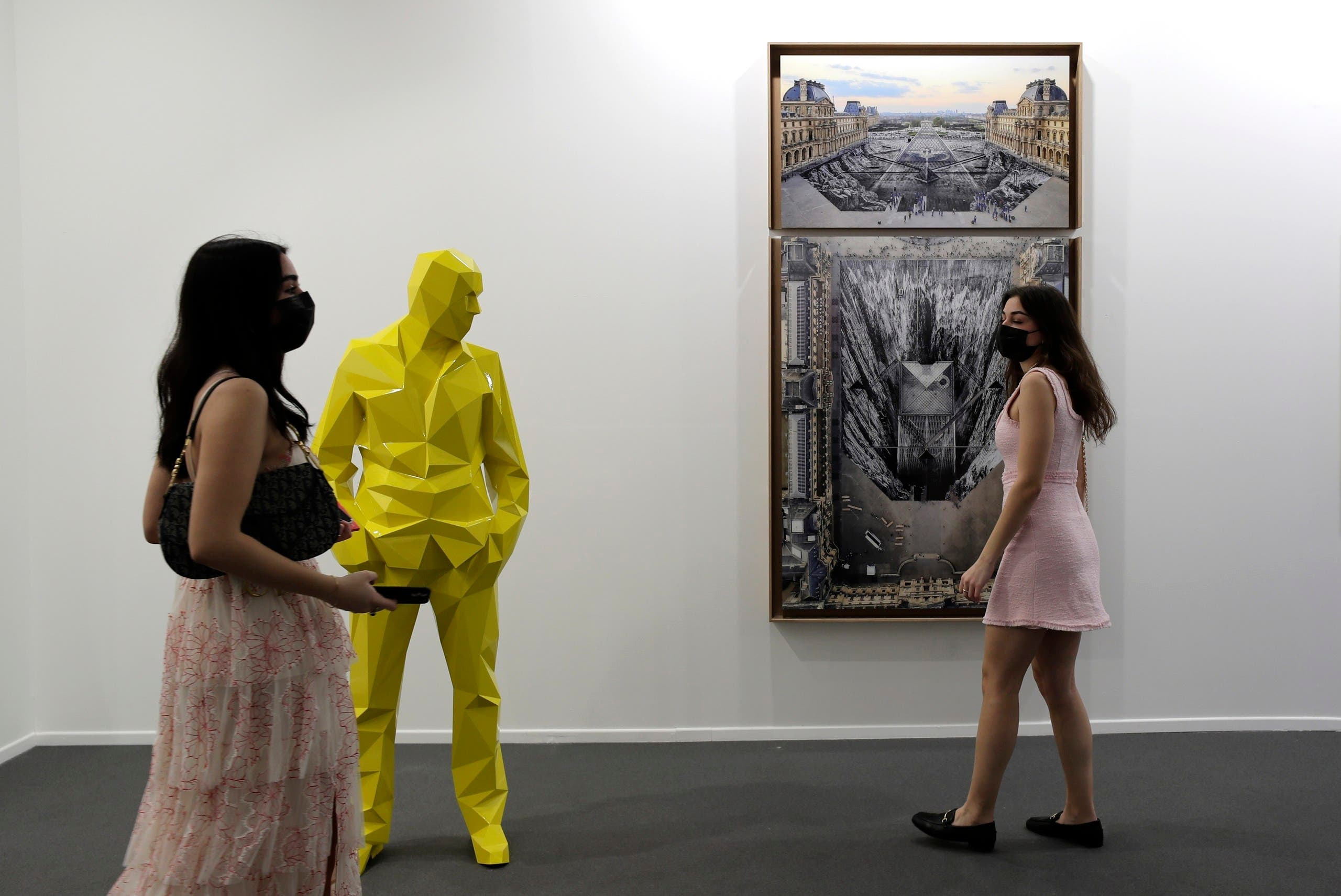 People visit Perrotin gallery of the 14th edition of Art Dubai at Dubai International Financial Centre, DIFC, which features 50 galleries from 31 countries with a focus on modern and contemporary art, in Dubai, United Arab Emirates, Tuesday, March 30, 2021. (File photo: AP))