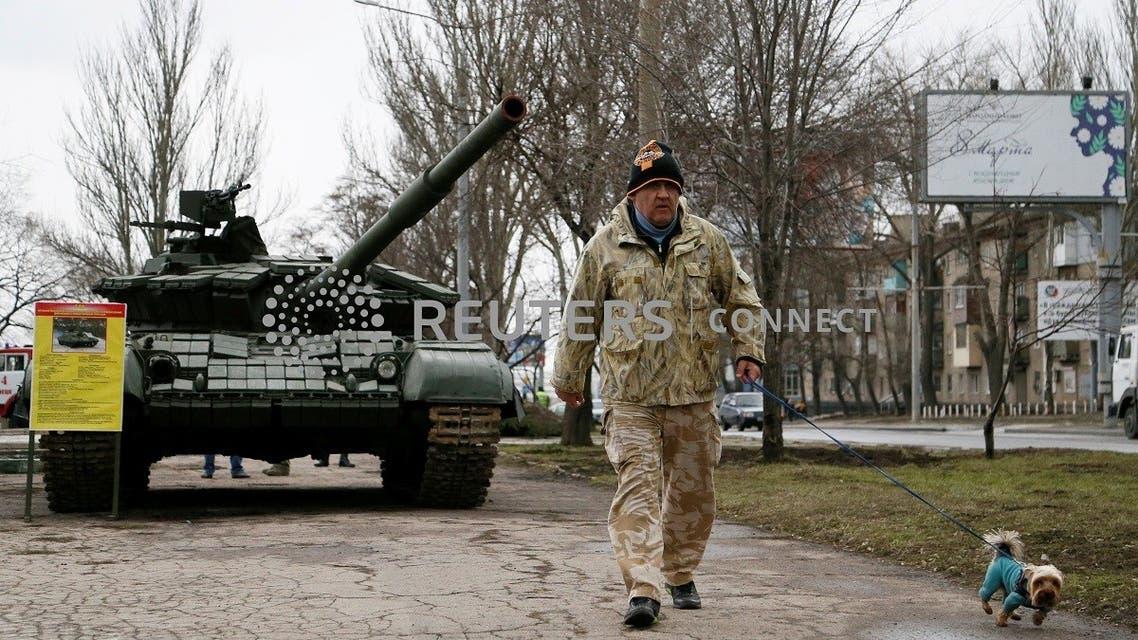 A man walks past a tank, in Donetsk, Ukraine (File photo: Reuters)
