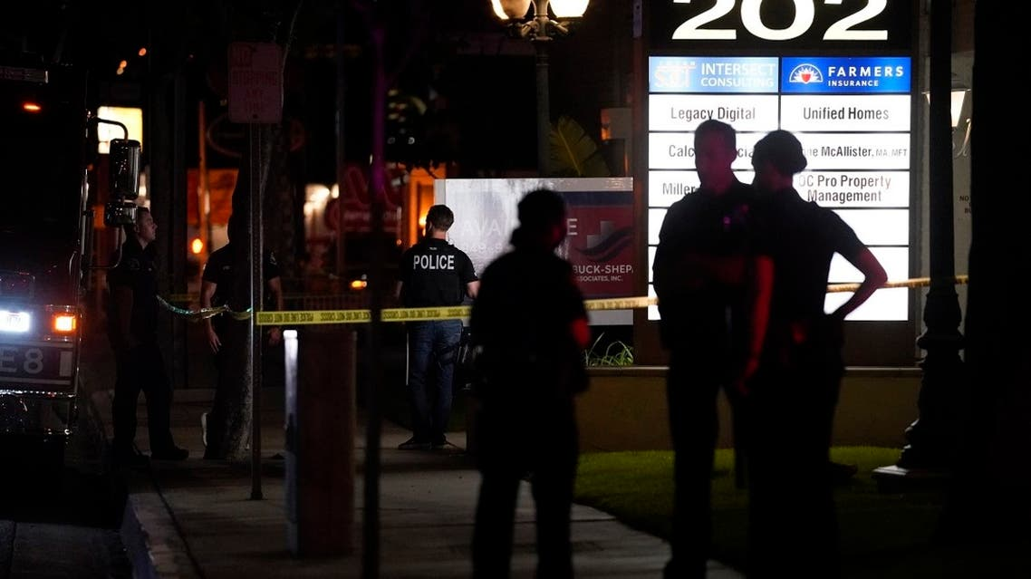 Police officers stand outside a business building where a shooting occurred in Orange, California, Wednesday, March 31, 2021. (AP)