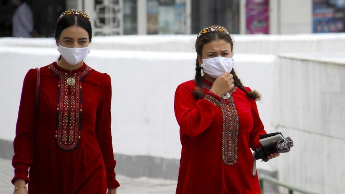 Turkmen women wearing face masks walk in Ashgabat on July 13, 2020. (AFP)
