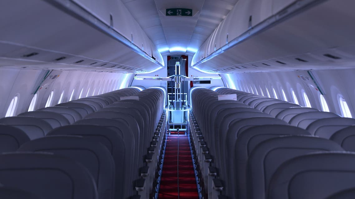 A robot developed by Swiss company UVeya armed with virus-killing ultraviolet light is seen aboard an airplane at Zurich Airport. (Reuters)