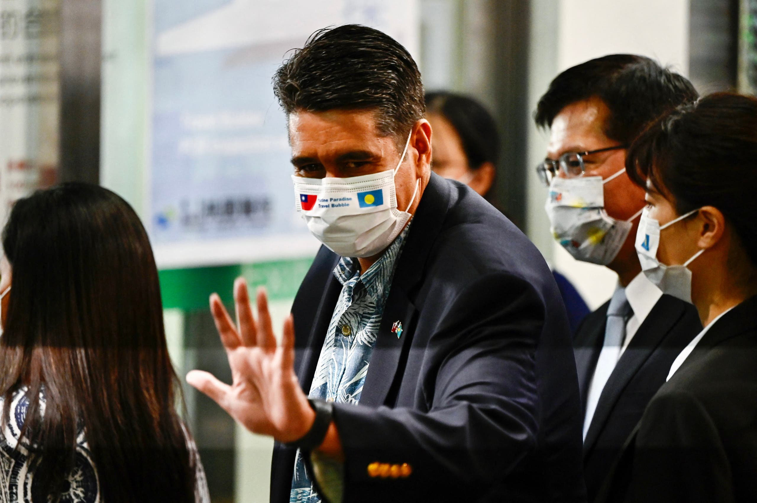 Palau President Surangel Whipps (C) waves as he departs from Taoyuan International Airport near Taipei on April 1, 2021, as Taiwanese tourists headed to Palau under the first travel bubble in Indo-Pacific Asia. (File photo: AFP)