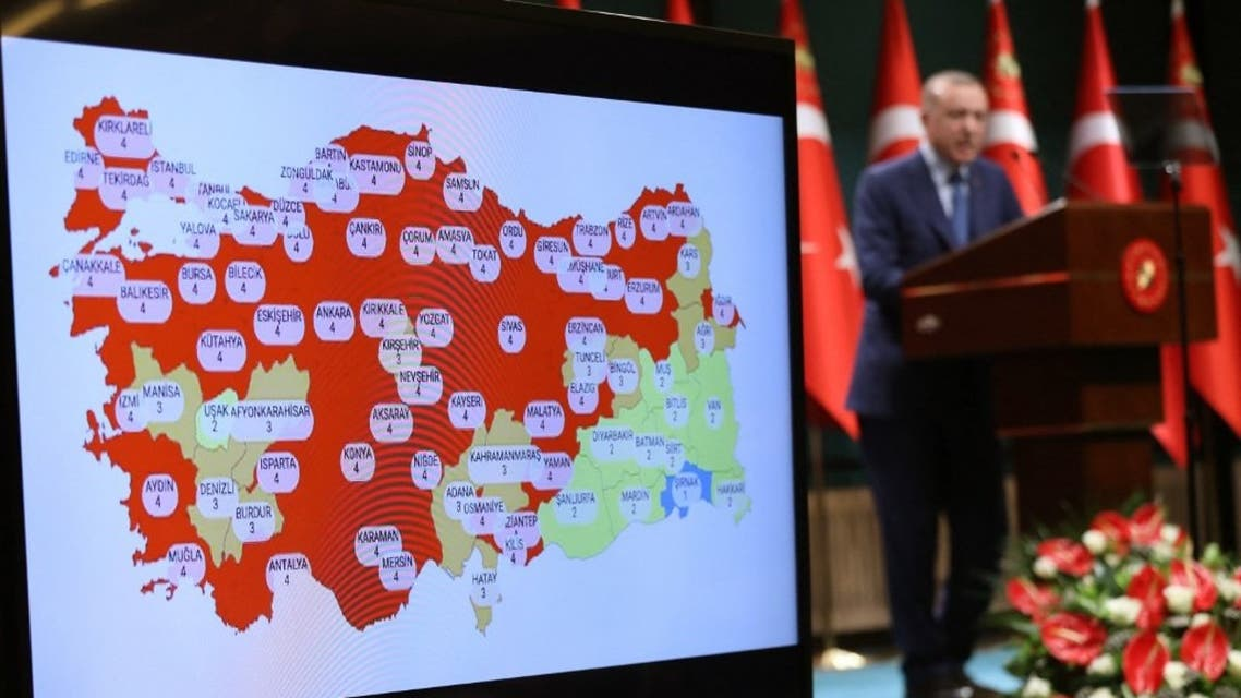 Turkish President Recep Tayyip Erdogan gives a press conference next to a map of Turkey with Covid-19 figures after the cabinet meeting at the presidential complex in Ankara, on March 29, 2021. (AFP)