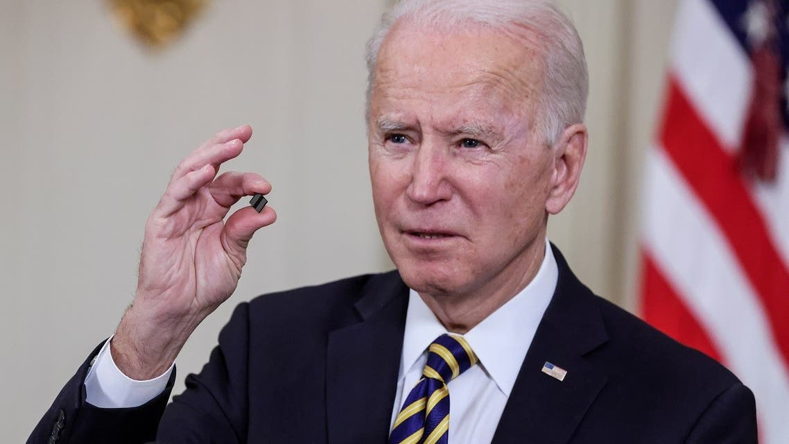President Joe Biden holds a chip as he speaks prior to signing an executive order aimed at addressing a global semiconductor shortage, in the State Dining Room at the White House in Washington, US, on February 24, 2021. (Reuters)