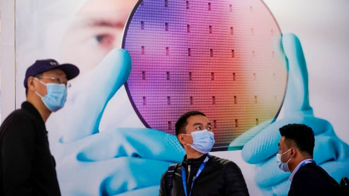 People visit a display of semiconductor device at Semicon China, a trade fair for semiconductor technology, in Shanghai, China, on March 17, 2021. (Reuters)