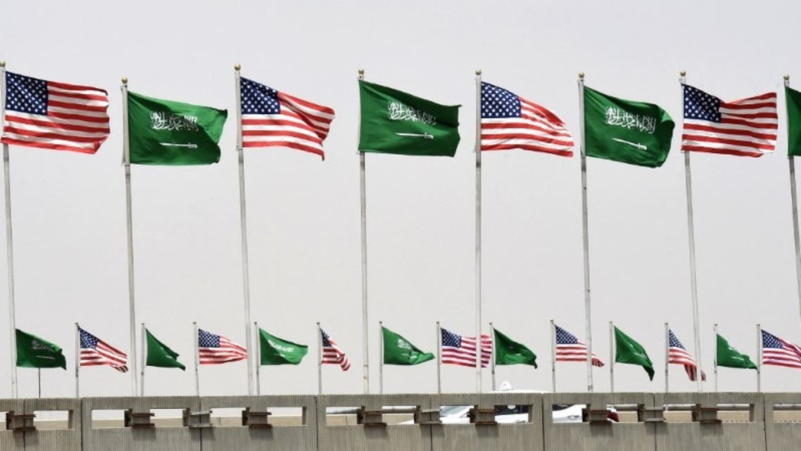 American and Saudi national flags are seen on a main road in Riyadh, on May 19, 2017. (AFP)