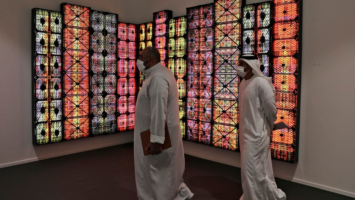 People visit Saudi artist Rashed Al Shashai's work titled Brand 14, Light Boxes, Plastic Cases, at the 14th edition of Art Dubai at Dubai International Financial Centre, DIFC, which features 50 galleries from 31 countries with a focus on modern and contemporary art, in Dubai, United Arab Emirates, Tuesday, March 30, 2021. (File photo: AP)